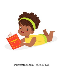 Sweet african girl lying on the floor and reading a book, colorful cartoon character vector Illustration