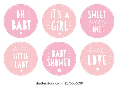 Sweet Baby Shower Vector Sticker Set. Round Blue Tags. It's a Girl. Oh Baby. Little Lady. Hello Love. White Hand Written Letters in a Circle with Seam Outline. Cute Cake Toppers.