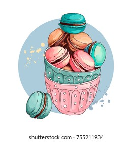 Sweet cute Macaroons in cups. Macaroons colorful french confections. Vector illustration. Hand drawn sketch.