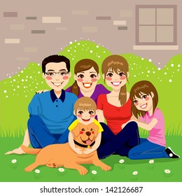 Sweet happy family posing together sitting in the backyard with their golden retriever dog