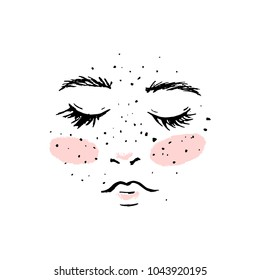 A sweet woman's face with freckles and pink cheeks.