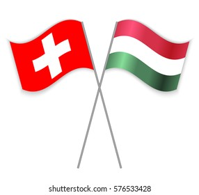 Swiss and Hungarian crossed flags. Switzerland combined with Hungary isolated on white. Language learning, international business or travel concept.