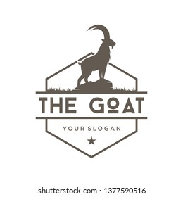 The symbol of a goat animal with a vintage logo, farm hexagon