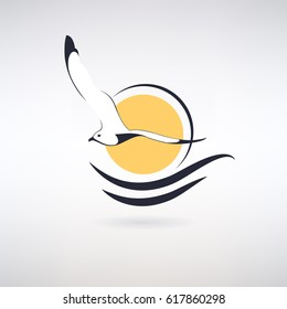 symbol seagull  on a background of the sun and sea waves