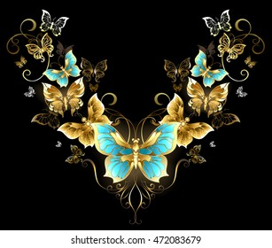 Symmetrical pattern of gold jewelry butterflies on black background.