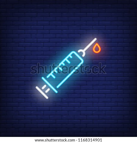 Syringe with blood drop neon sign. Medicine and healthcare concept.  Advertisement design. Night 768ef3970