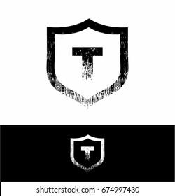 T letter Logo in shield grunge design vector