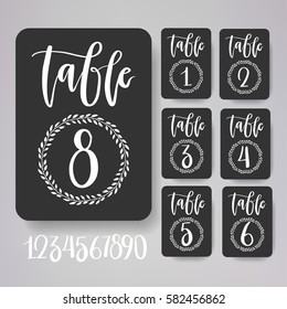 Table number card collection including all numbers for your need. Perfect for wedding or anniversary design. White hand written lettering on a black background.