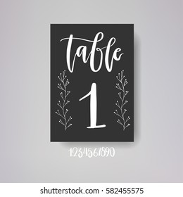 Table number card. One of wedding or anniversary cards collection. White hand written lettering on a black background.