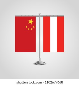 Table stand with flags of China and Austria.Two flag. Flag pole. Symbolizing the cooperation between the two countries. Table flags