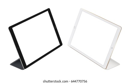 Tablet computer Apple iPad Pro with Smart Cover isolated on white background. Black and white tablets stand with cases. Thin, minimal design. Vector illustration