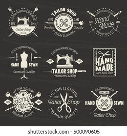 Tailor shop set of vector light emblems, labels and badges isolated on dark background with grunge texture