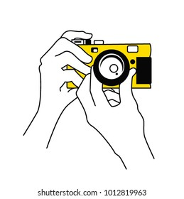 Taking a photo with yellow camera