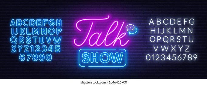 Talk show neon sign on brick wall background.