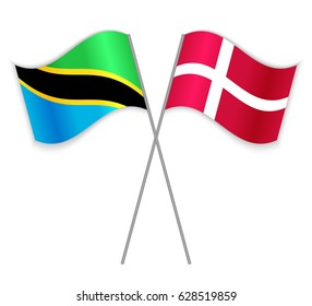 Tanzanian and Danish crossed flags. Tanzania combined with Denmark isolated on white. Language learning, international business or travel concept.