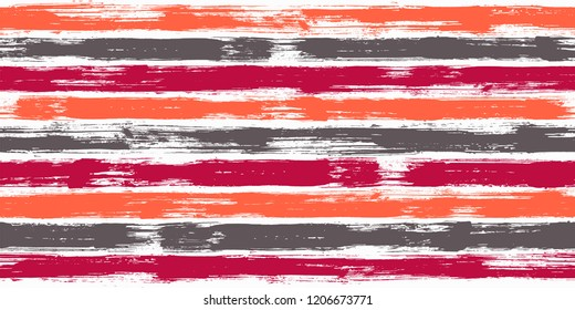 Tartan watercolor brush stripes seamless pattern. Orange and red paintbrush lines horizontal seamless texture for background. Hand drown paint strokes decoration artwork. For illustration.