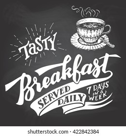 Tasty breakfast served daily, seven days in a week. Hand lettering with a sketch of a coffee cup. Vintage typography illustration for cafe and restaurant. Chalkboard style on a blackboard background