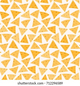 Tasty colorful crispy mexican food nachos seamless pattern. Nice spanish fastfood texture for textile, wallpaper, background, cover, banner, bar and cafe menu design