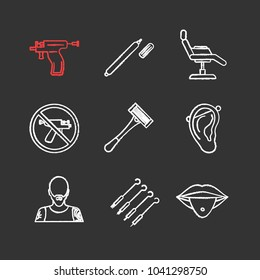 Tattoo studio chalk icons set. Piercing service. Highlighter, tattoo chair, piercing gun prohibition, razor, pierced ear and tongue, tattooist, ink needles. Isolated vector chalkboard illustrations