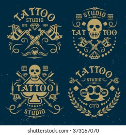 Tattoo studio or salon set of vector vintage emblems, labels, logo templates, on dark blue background with grunge texture