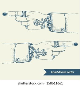 Tattooed hand and with pointing finger. Hand drawn vector illustration.