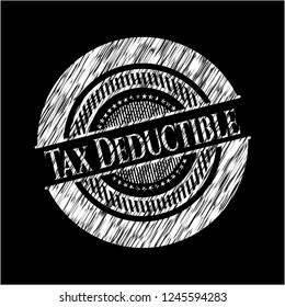 Tax Deductible chalk emblem written on a blackboard