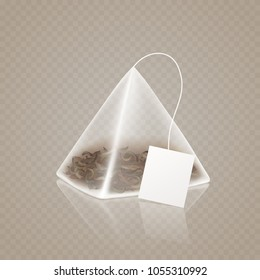 Tea bag pyramid shape isolated on transparent background. Realistic 3d teabag with label. Vector mock up for your tea advertising design.