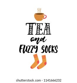 Tea and fuzzy socks - hand drawn cozy Autumn or Winter seasons holiday lettering phrase and Hugge doodles cup and warm socks isolated on background. Fun brush illustration for cards, posters design