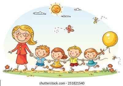 Teacher leading kids for a walk in the kindergarten