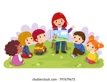Teacher telling a story to nursery children in the garden