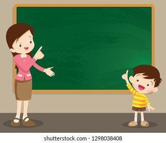 Teacher woman and studen boy standing in front of chalkboard.Cute kid imagine in classroom with space for your text.
