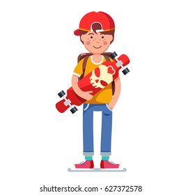 Teen kid boy in baseball cap wearing backpack standing and holding longboard skateboard with a skull print. Young hipster longboarder. Flat style character vector illustration isolated on white.