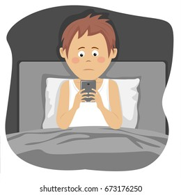 Teenager boy uses smartphone sitting in bed at night