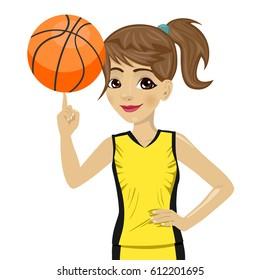 teenager girl spinning basketball ball with her finger