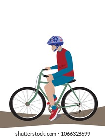 A teenager with a helmet ride a bike