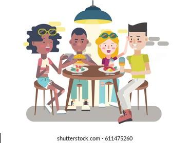 Teens eating, chatting and having fun at restaurant