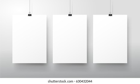 Template of three white blank vector posters. Set of mockups hanging on the wall. Frame for paper sheet. Isolated on gray background. Vector illustration EPS 10.