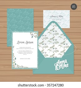 Template wedding invitation and envelope with floral ornament. Greeting card and envelope mock up. Vector illustration.