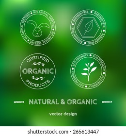 Templates and labels for organic cosmetics, products on green blurred background.