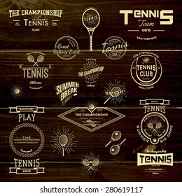 Tennis badges logos and labels for any use, on wooden background texture