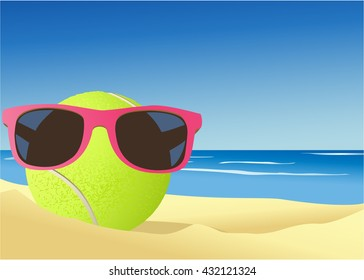 Tennis ball on the beach sand