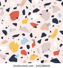 Terrazzo seamless pattern with colorful rock pieces. Abstract backdrop with stone sprinkles scattered on light background. Modern vector illustration for fabric print, wrapping paper, flooring.