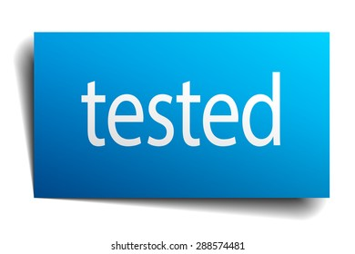 tested blue paper sign isolated on white