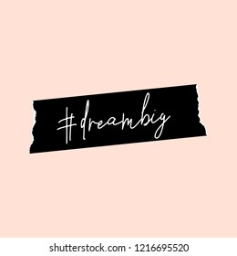 Text #dreambig in white written on a black washi tape, isolated on pastel pink background. Inspirational square wall art, social media post, greeting card, t-shirt design.