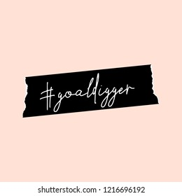 Text #goaldigger in white written on a black washi tape, isolated on pastel pink background. Inspirational square wall art, social media post, greeting card, t-shirt design.