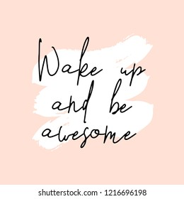 Text Wake Up and Be Awesome written in black, white brushtrokes and pastel pink background. Creative and modern square wall art, social media post, greeting card, t-shirt design.