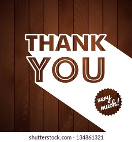 Thank you card with typography on a wooden background. Vector image.