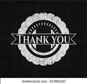 Thank you chalk emblem written on a blackboard