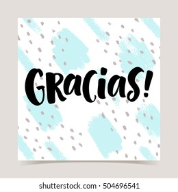 Thank you lettering in spanish: Gracias! Hand drawn phrase on abstract texture background. Handwritten modern brush calligraphy for invitation and greeting card, t-shirt, prints and posters