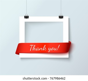 Thank you word with white photoframe and red curve ribbon with space for text or photo isolated on light gray background
